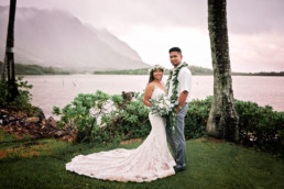 Wedding couple by ocean at Kualoa Ranch area Oahu