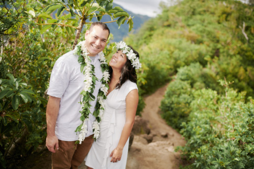 Bride and groom standing along the ridge trail at Waahila State Park Oahu